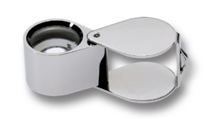Loupe magnifying glass in leather case